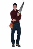 Handyman with a handsaw Stock Image