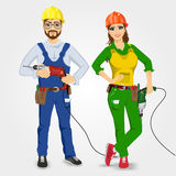 Handyman and handywoman holding drills Stock Photo