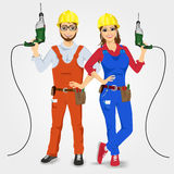 Handyman and handywoman holding green drills Stock Photography
