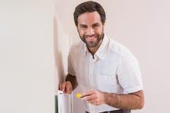 Handyman hanging up a radiator Stock Images