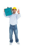 Handyman in hard hat with toolbox gesturing okay sign Royalty Free Stock Photography