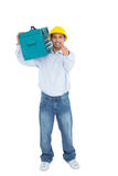 Handyman in hard hat with toolbox gesturing thumbs up Royalty Free Stock Photo