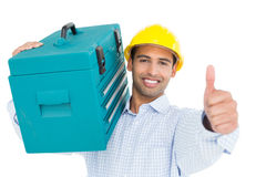 Handyman in hard hat with toolbox gesturing thumbs up. Portrait of a smiling handyman in hard hat carrying a toolbox and gesturing thumbs up against white Stock Images