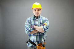 Handyman in helmet Royalty Free Stock Image
