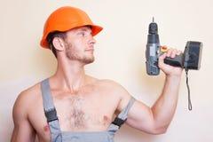 Handyman in helmet with screwdriver Royalty Free Stock Photos