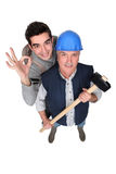 A handyman and his trainee. Royalty Free Stock Images