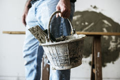 Handyman holding basket cement for construction royalty free stock photos