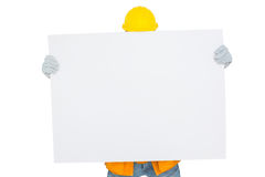 Handyman holding blank placard Royalty Free Stock Images