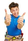 Handyman holding both thumbs up. Cheering handyman holding both of his thumbs up royalty free stock photography
