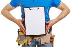 Handyman holding empty clipboard Stock Photos