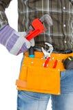 Handyman holding hand tool Stock Images