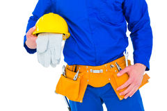 Handyman holding helmet Stock Images
