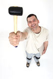 Handyman holding a mallet. In the air Stock Photo