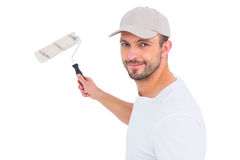 Handyman holding paint roller Royalty Free Stock Images
