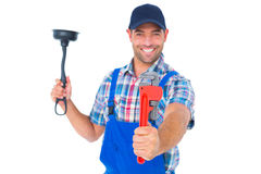 Handyman holding plunger and wrench on white background Royalty Free Stock Photos