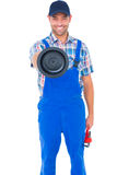 Handyman holding plunger and wrench on white background Royalty Free Stock Images