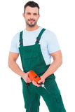 Handyman holding power drill. On white background Stock Photos