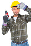 Handyman holding power drill. On white background Stock Photography