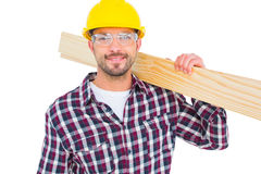 Handyman holding wood planks Royalty Free Stock Photography