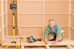 Handyman home improvement wooden floor renovation Royalty Free Stock Images