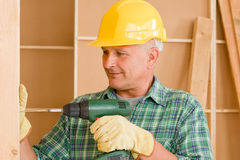 Handyman home improvement working with screwdriver Stock Photo
