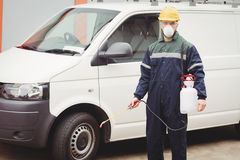 Handyman with insecticide Royalty Free Stock Images