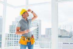 Handyman inspecting building Stock Image