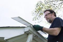 Handyman Installing Gutter Guards Royalty Free Stock Photos