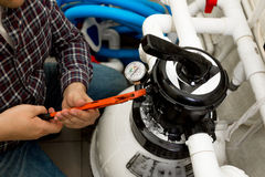 Handyman installing manometer on high pressure system Royalty Free Stock Photos