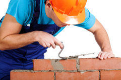 Handyman installing red brick Royalty Free Stock Photo