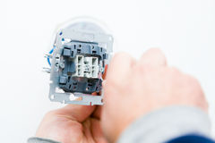 Handyman Installing Socket Royalty Free Stock Images