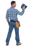 A handyman with a jigsaw. Stock Photos