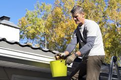 Roof and Eavestrough Maintenance Stock Images
