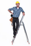 An handyman on a ladder. Royalty Free Stock Photos