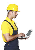 Handyman with laptop Stock Photography