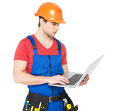 Handyman with laptop isolated on  white Stock Photography