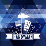 Handyman logo on  polygonal background in blue. Stock . Flat design Stock Photo