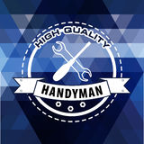 Handyman logo on  polygonal background in blue. Stock . Flat design Royalty Free Stock Photos