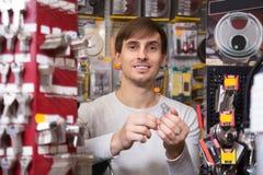 Handyman making door keys copies Stock Photography
