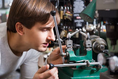 Handyman making door keys copies Royalty Free Stock Photos