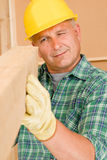 Handyman mature carpenter measure wooden beam Stock Photos