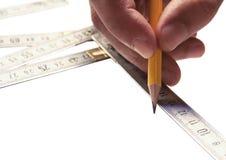Handyman measure Royalty Free Stock Photos