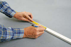 Handyman measuring channel Stock Photography