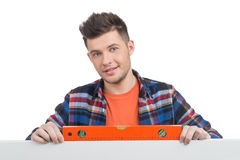 Handyman measuring level. Stock Photo