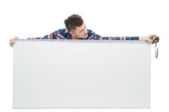 Handyman measuring level. Confident young craftsperson measuring the level with special tool royalty free stock photos