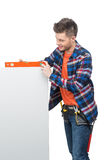 Handyman measuring level. Stock Photos