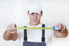 Handyman with measuring tape Royalty Free Stock Image