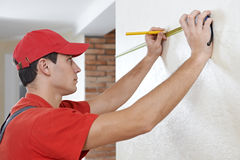 Handyman with measuring tape Stock Photo