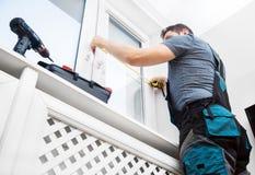 Handyman measuring window. For cassette roller blinds royalty free stock images