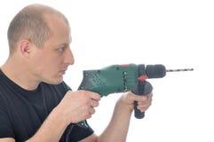 Handyman med drillborren royaltyfria foton